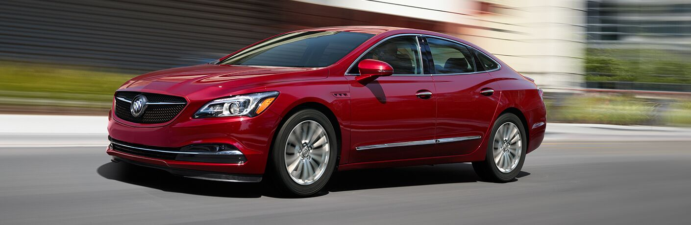 Exterior view of a red 2019 Buick LaCrosse driving down a city street