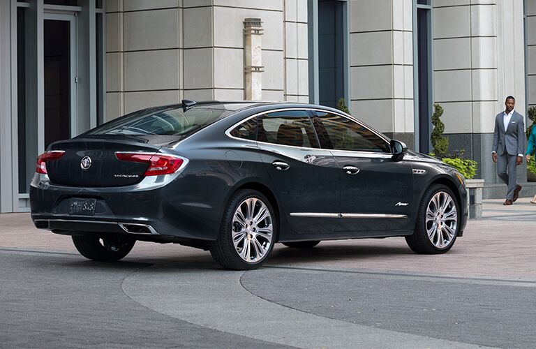 Exterior view of the rear of a black 2019 Buick LaCrosse parked outside an office building