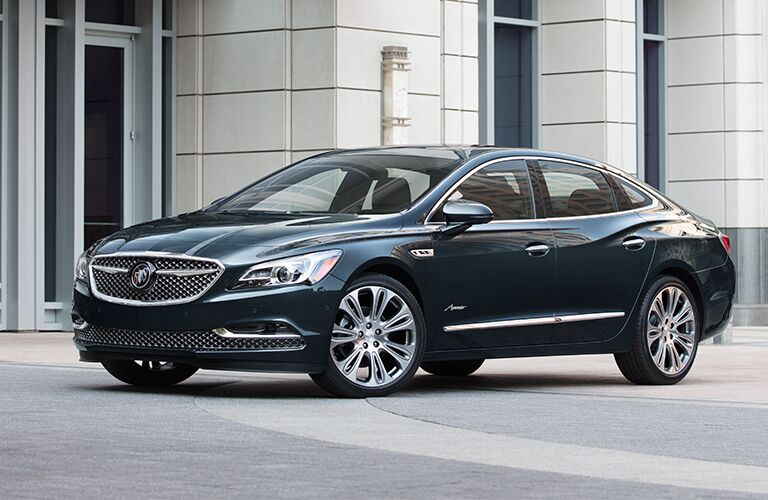 Exterior view of the front of a black 2019 Buick LaCrosse parked outside an office building