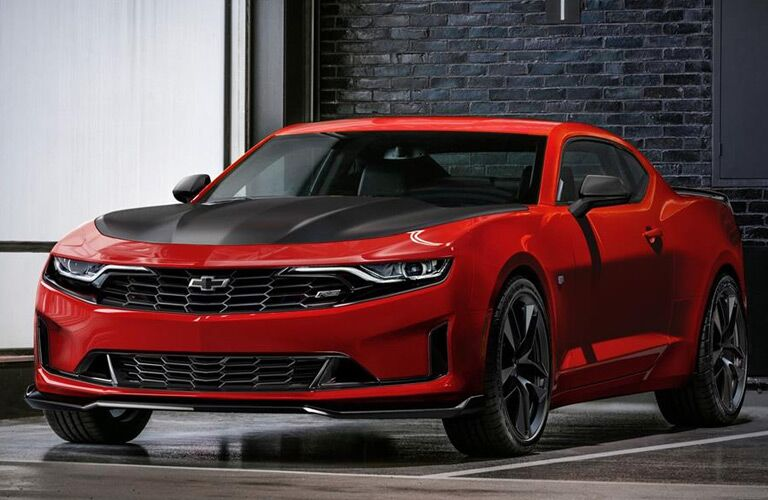 Exterior view of a red 2019 Chevrolet Camaro parked in a parking garage