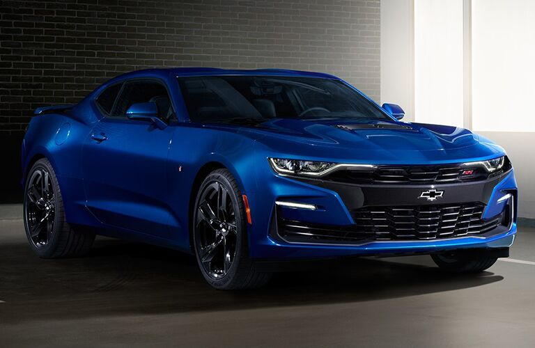 Exterior view of a blue 2019 Chevrolet Camaro parked in a parking garage