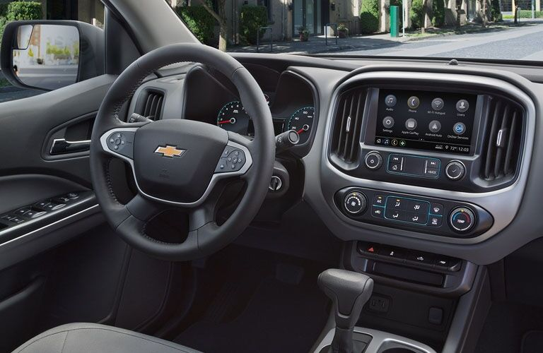 Interior view of the steering wheel and touchscreen inside a 2019 Chevrolet Colorado