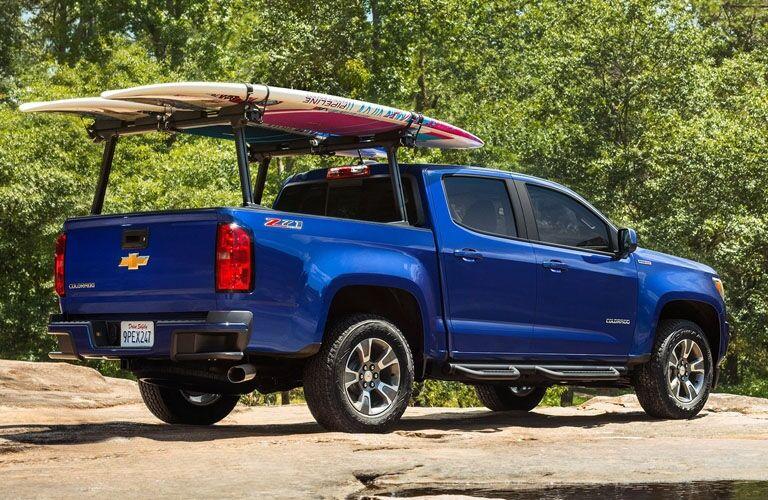 Exterior view of a blue 2019 Chevrolet Colorado parked near the beach