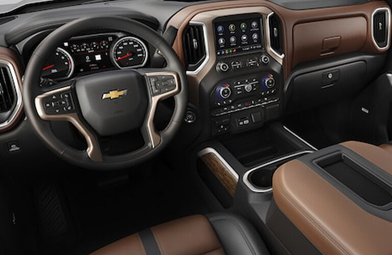 Interior view of the steering wheel and infotainment system of a 2019 Chevrolet Silverado 1500