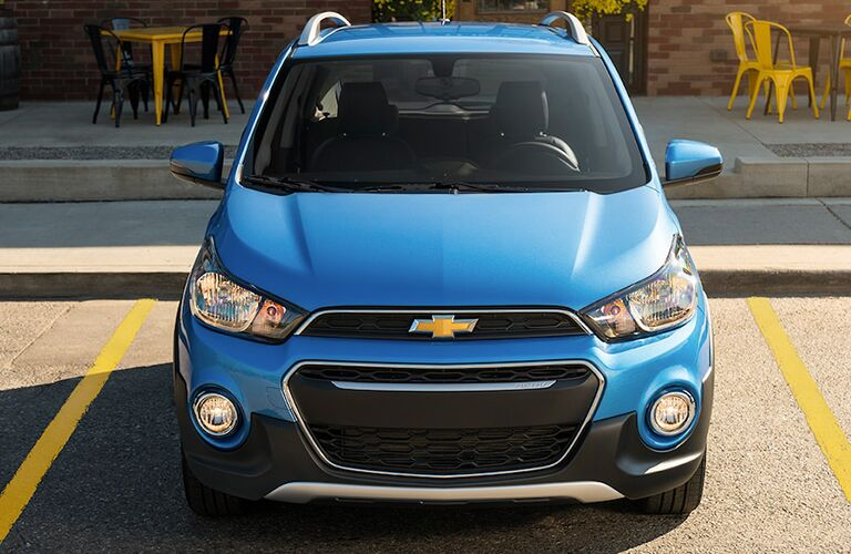 Blue 2019 Chevrolet Spark parked inside of a parking space