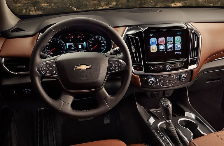 Interior view of the black steering wheel and touchscreen inside a 2019 Chevrolet Traverse