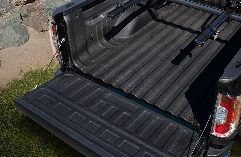 Closeup view of the truck bed of a black 2019 GMC Canyon