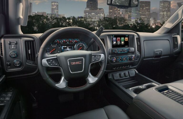 Interior view of the steering wheel and touchscreen inside a 2019 GMC Sierra 3500HD