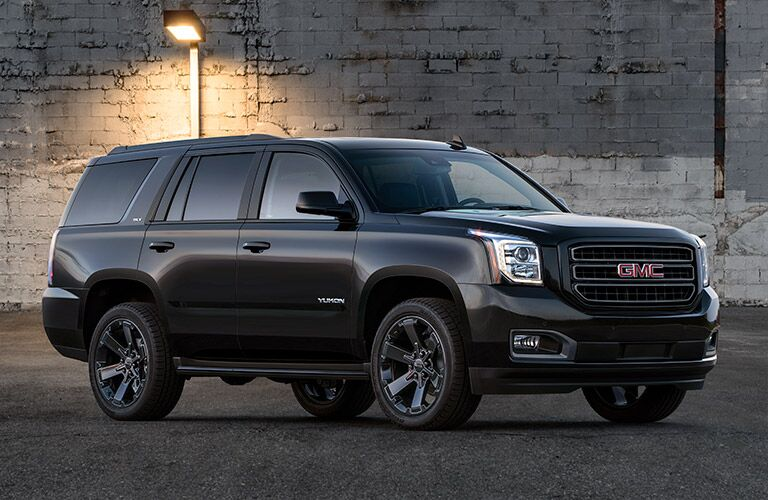 Exterior view of a black 2019 GMC Yukon parked in an alley