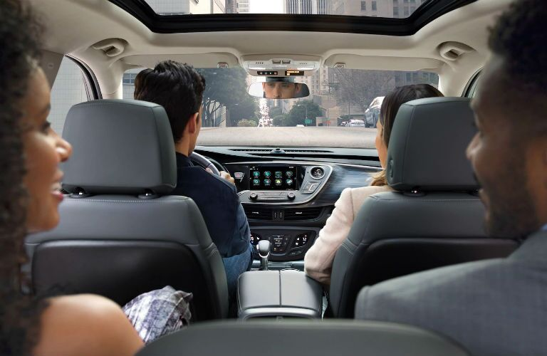 Interior view of four adults riding inside the 2019 Buick Envision