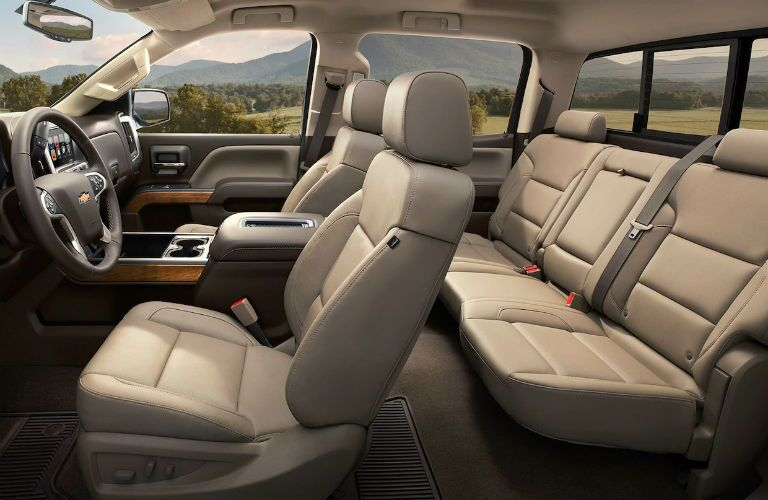 Interior view of the beige seating inside a 2019 Chevrolet Silverado HD