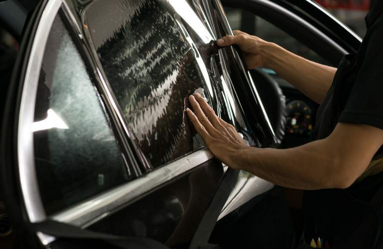 Technician fixing car window