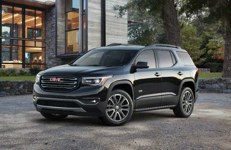 2017 GMC Acadia parked outside of a home