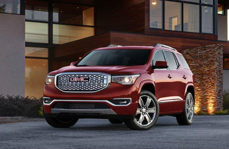 2017 GMC Acadia Denali parked outside an office building