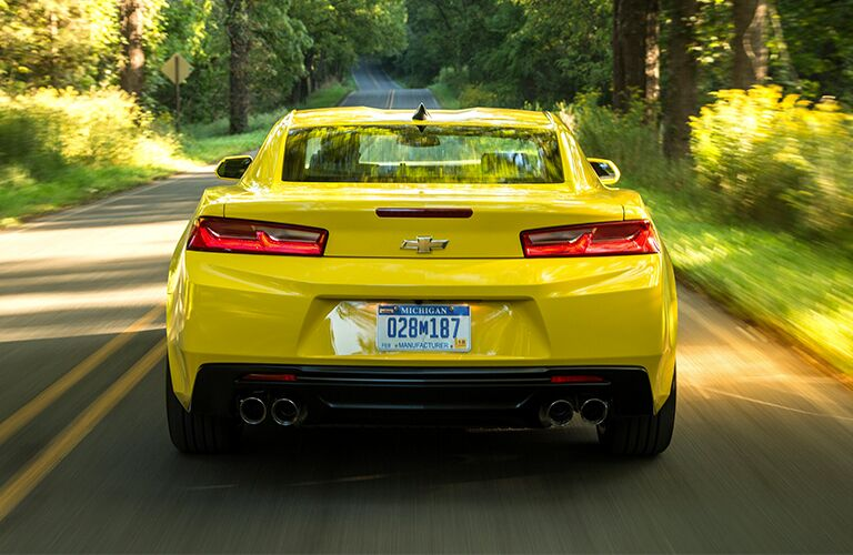 Rear view of a 2018 Chevy Camaro as it drives away.
