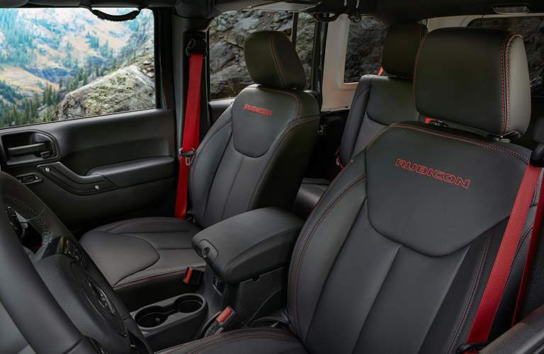 drivers and passengers seats in 2018 jeep wrangler jk rubicon shown with black leather interior trim on mountain