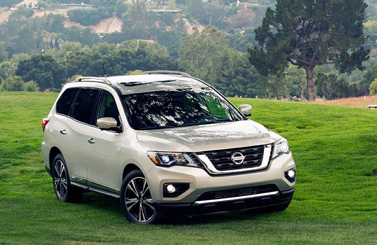 2018 Nissan Pathfinder Front View of Silver Exterior with Green Landscape