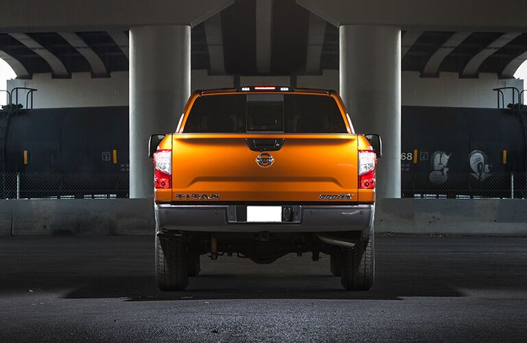 View of the rear of a 2019 Nissan Titan, parked in a parking garage.