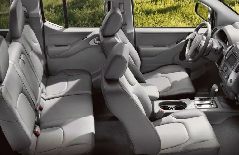 2019 Nissan Frontier interior cabin raised side view. Front and rear rows of seats.