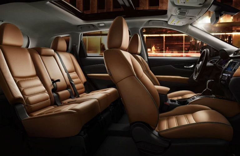 Interior side view of the front and back rows of the 2019 Nissan Rogue.