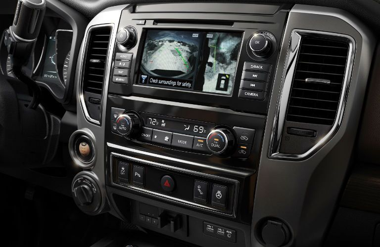 Interior infotainment and amenity controls in a 2019 Nissan Titan XD.