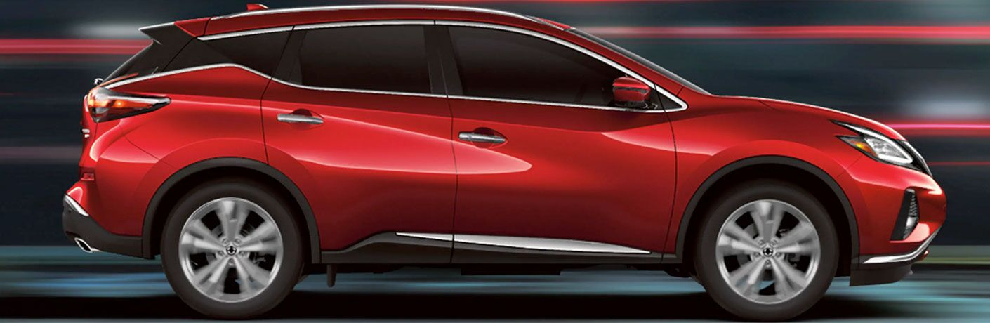 side view of red nissan murano