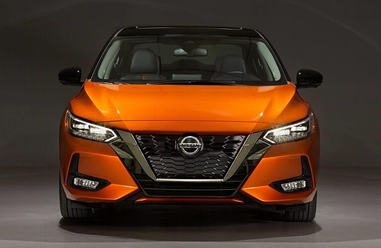 front view of orange nissan sentra