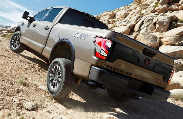 2020 Nissan Titan climbing up incline from exterior rear