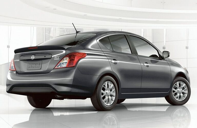 A rear right quarter photo of the 2019 Nissan Versa in a photo studio.