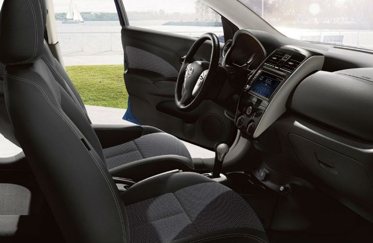 A photo of the front seats and infotainment system used in the 2019 Versa.