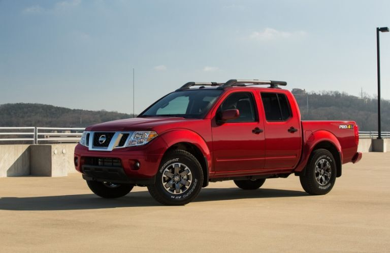 Red 2020 Nissan Frontier from drivers side