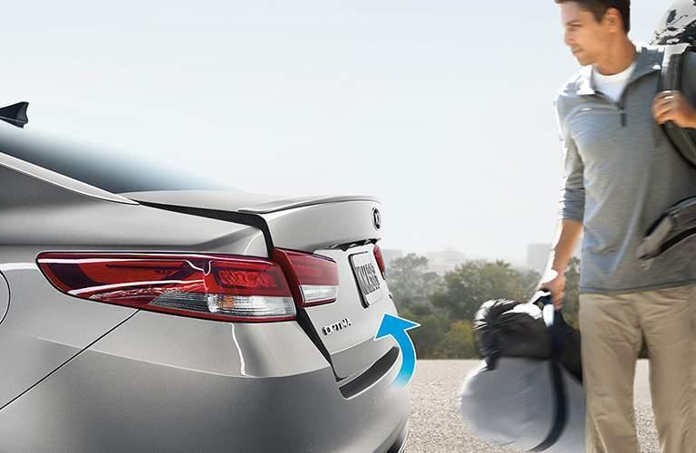2018 Kia Optima exterior view of trunk with man next to it