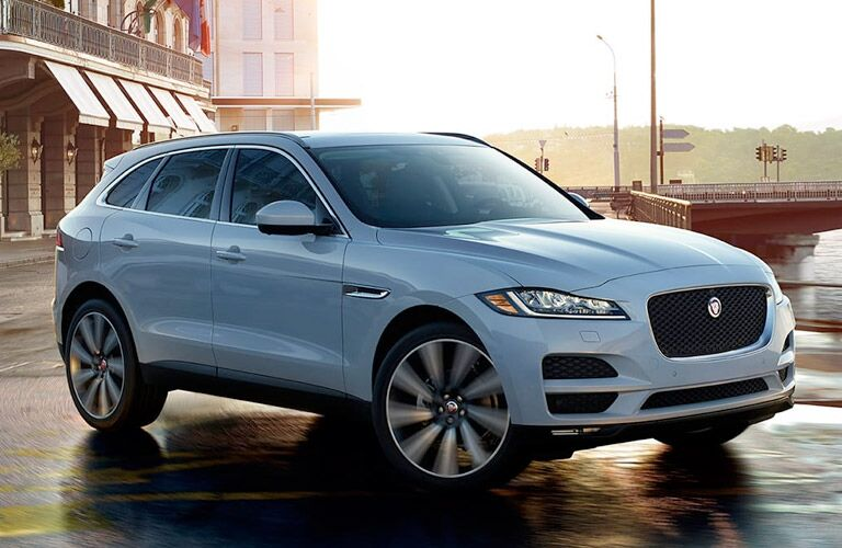 2018 Jaguar F-PACE driving on waterfront road