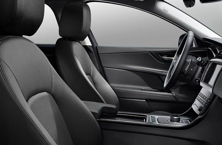 Two front seats and steering wheel of 2018 Jaguar XE