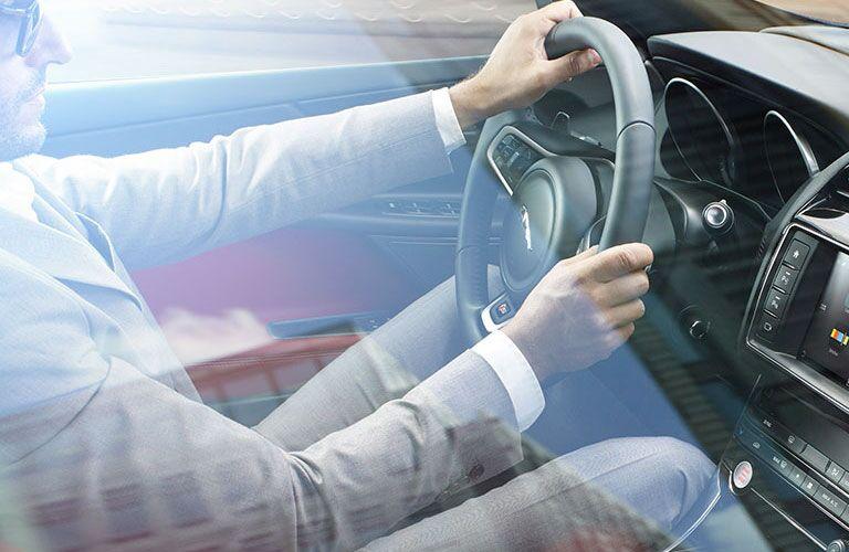 Man driving in 2018 Jaguar XE
