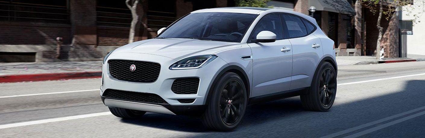 Driver side exterior view of a white 2018 Jaguar E-Pace