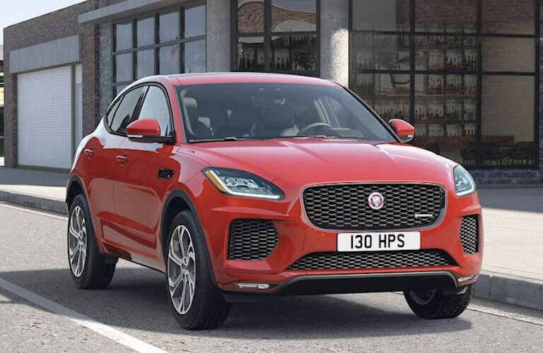 Exterior view of the front of a red 2019 Jaguar E-PACE parked on a city street