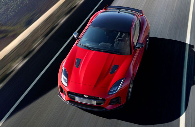 Overhead view of red 2019 Jaguar F-TYPE with carbon fiber roof