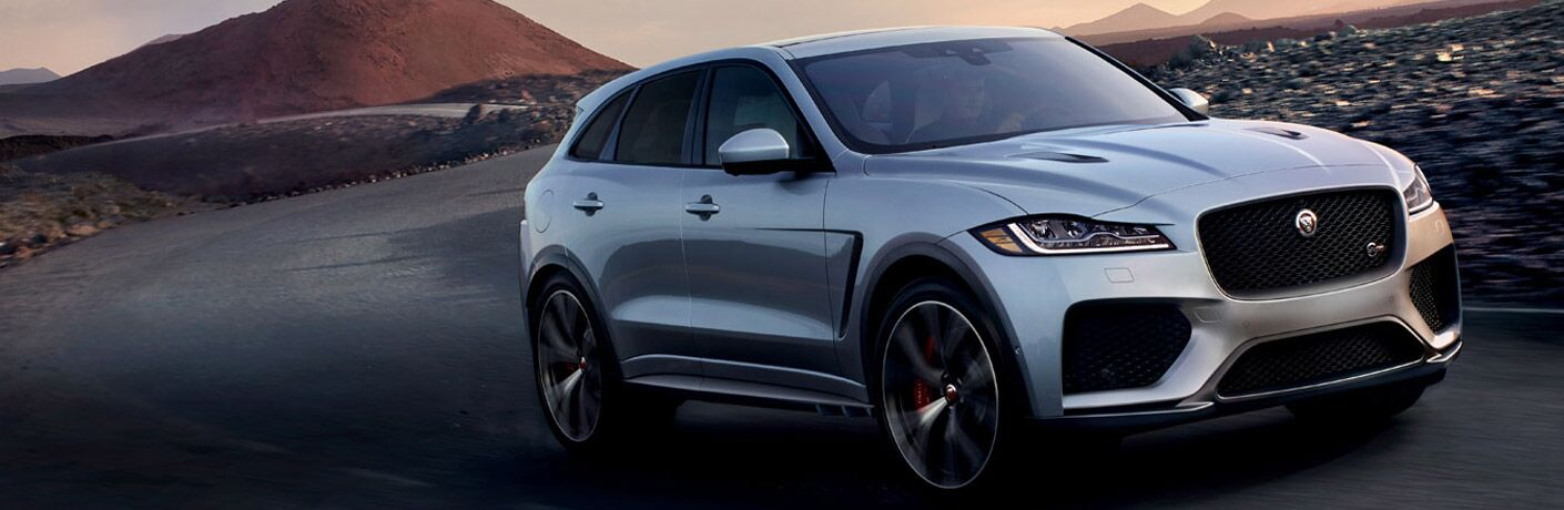 Front passenger side exterior view of a gray 2019 Jaguar F-Pace