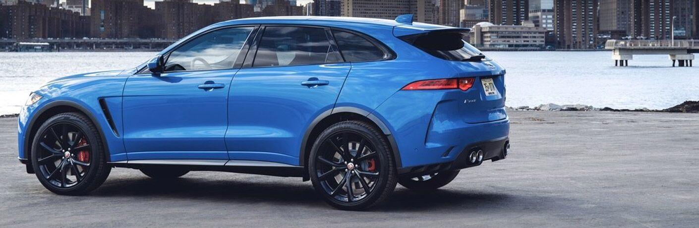side view of a blue 2019 Jaguar F-Pace