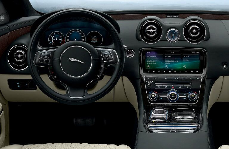 Interior view of the steering wheel and dashboard of a 2019 Jaguar XJ