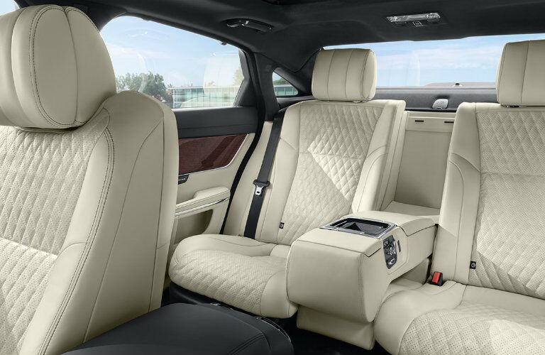Interior view of the beige leather seating of a 2019 Jaguar XJ