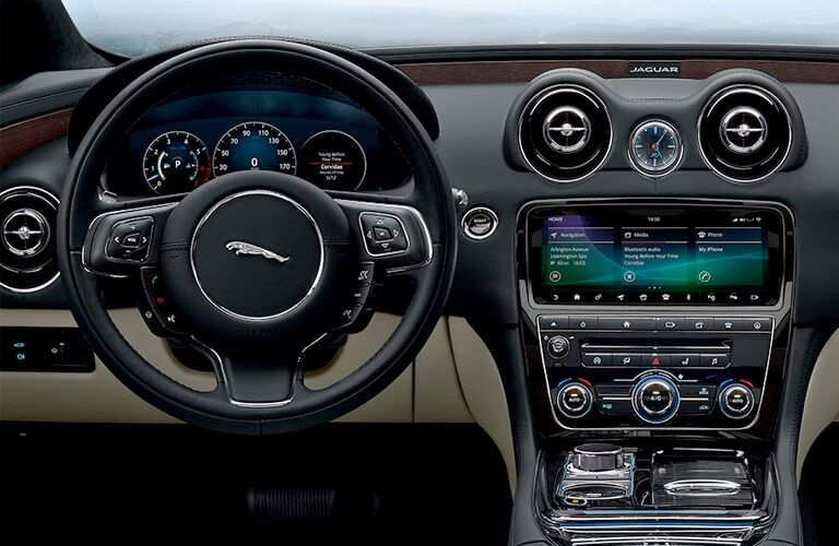 Interior view of the steering wheel and touchscreen inside a 2019 Jaguar XJ