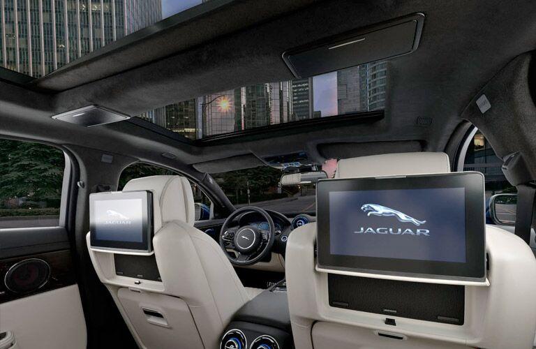 Interior view of the rear headrest displays inside a 2019 Jaguar XJ