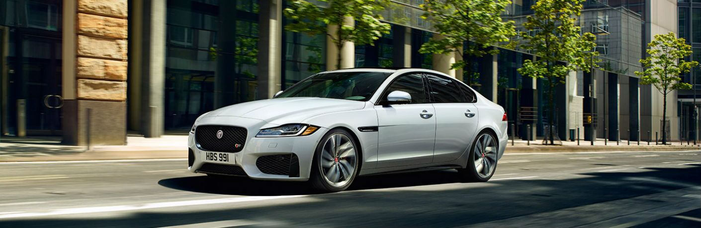 Driver side exterior view of a white 2019 Jaguar XF sedan