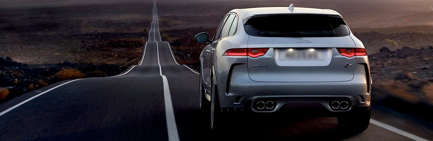 Silver 2020 Jaguar F-PACE driving on a barren road