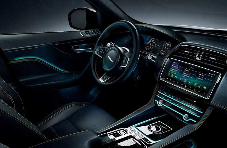 Dashboard and black driver's seat in 2020 Jaguar F-PACE