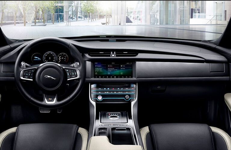 Dashboard and black and white front seats in 2020 Jaguar XF Sedan