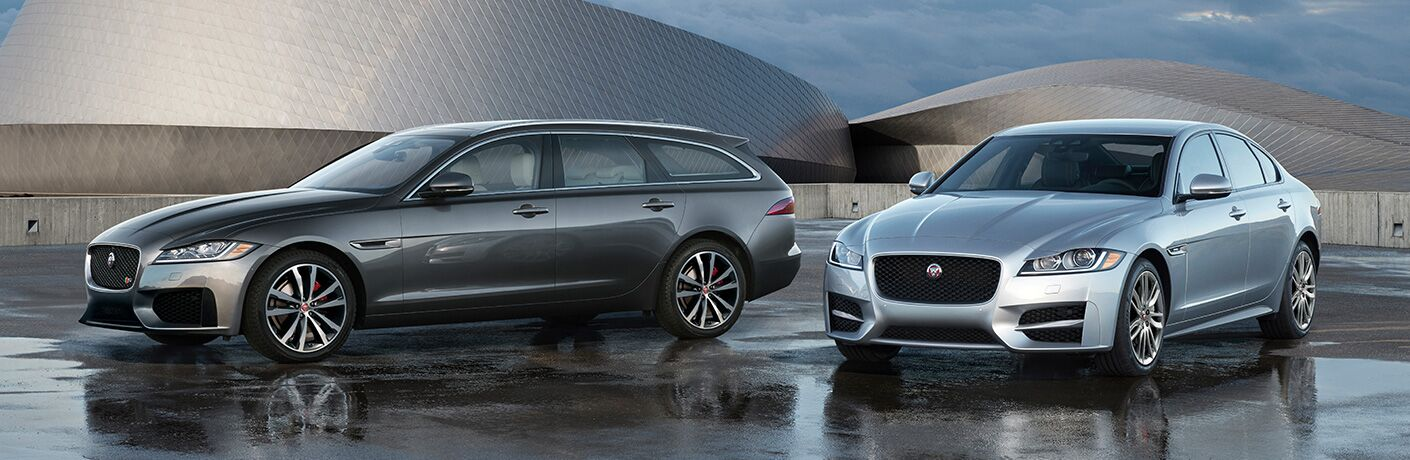 Grey 2020 Jaguar XF SportBrake Wagon and silver 2020 Jaguar XF Sedan parked near a modernist building