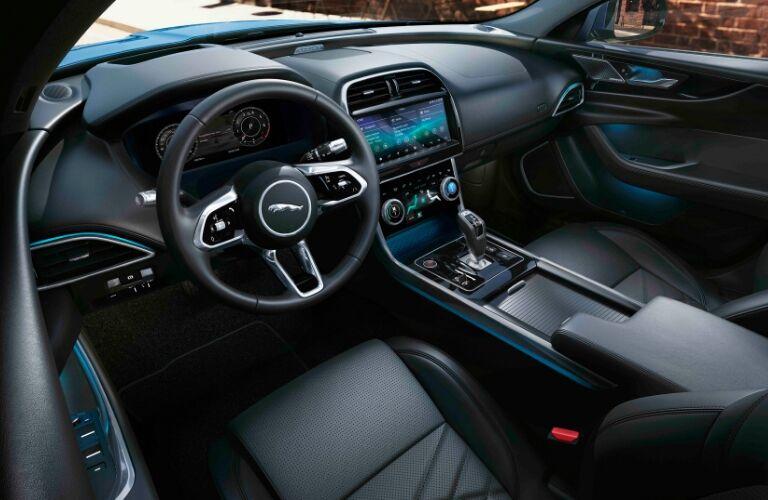 Steering wheel, gauges, and touchscreen in 2020 Jaguar XE